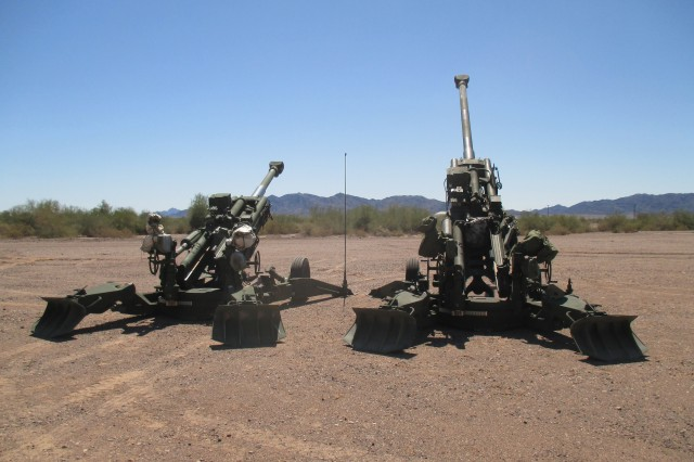 "The M777A2 and M777ER side by side at a test site. Retrofitting an M777A2 howitzer into an M777ER—the ""ER"" stands for extended range—only requires changing five components, which add little additional weight or cost. The long-range cannon project team is evaluating whether equipping artillery batteries with the extended-range howitzer plus new radar and tracking systems can increase their firepower while the Army develops more significant modernization solutions for long-range precision fires."