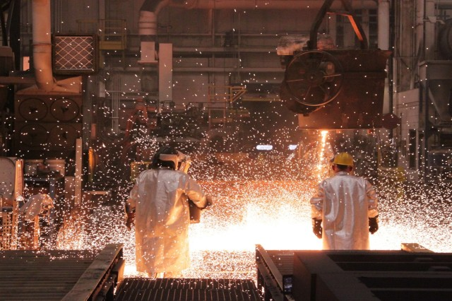 Workers at a government arsenal pour molten steel into a mold. Government arsenals including those at Rock Island, Illinois, and Watervliet, New York, will produce several of the components for the extended-range variant of the M777 howitzer. Working with government depots and arsenals gives program managers flexibility, allowing them to move money around as project needs dictate without going through the steps required to change cost and schedule parameters under a commercial contract.  (Photo by Kimberly Conrad, Joint Manufacturing and Technology Center)