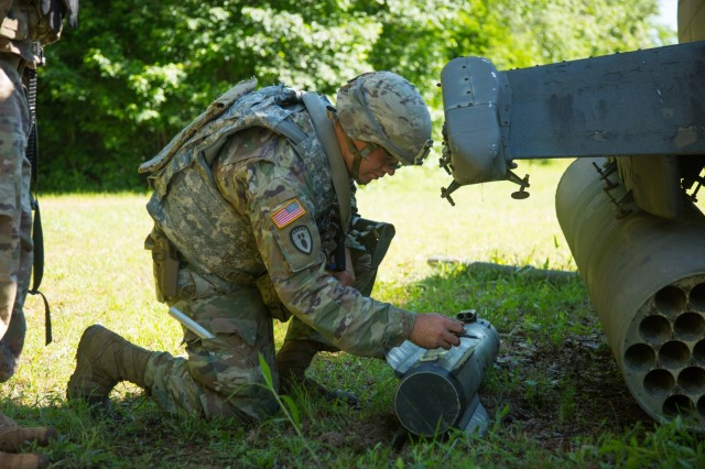 Staff Sgt. Joshua Papineau, an explosive ordnance disposal team leader with the 68th Chemical, Biological, Radiological, Nuclear, Explosives Company from Fort Hood, Texas, works to aid in the disarmament of simulated explosives on the Crash Site lane at Fort A.P. Hill, June 5, 2018. EOD teams are assessed on operations and associated tasks required to provide EOD support to unified land operations to eliminate and/or reduce explosive threats. The Ordnance Crucible is designed to test Soldiers' teamwork and critical thinking skills as they apply technical solutions to real world problems improving readiness of the force. (U.S. Army photo by Spc. Shekinah M. Frye)