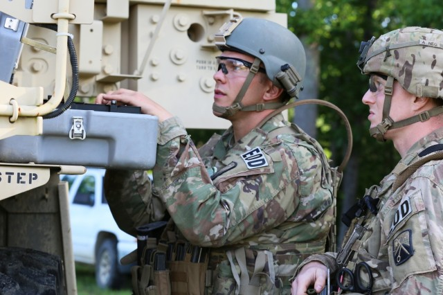 1st Lt. Jesse Way, an ordnance disposal team member and his team leader with 720th Ordnance Company from Baumholder, Germany, along with Staff Sgt. Ryan Essenmacher, work together as they review information during the 2018 Ordnance Crucible, June 5, 2018, at Fort A.P Hill, Va. EOD teams are assessed on operations and associated tasks required to provide EOD support to unified land operations to eliminate and/or reduce explosive threats. The Ordnance Crucible is designed to test Soldiers' teamwork and critical thinking skills as they apply technical solutions to real world problems improving readiness of the force. (U.S. Army photo by Pfc. Christian Simmons)