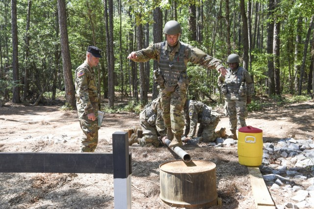 U.S. Army National Guard Officer Candidates from Florida, Georgia, North Carolina, Puerto Rico and South Carolina participate in the Leadership Reaction Course at McCrady Training Center, Eastover, South Carolina, June 7, 2018. The candidates must employ Troop Leading Procedures and apply leadership attributes and competencies they have learned while working as a team in order to negotiate the obstacles successfully.