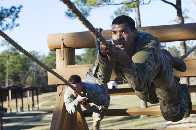 Army Reserve Soldiers Spc. Joshua Thomas and Spc. John Moore complete a rope obstacle at the Army National Guard Warrior Training Center at Fort Benning, Ga., during the Deployment Support Command's 2017 Best Warrior Competition.