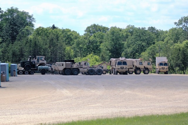 Military vehicles are parked at a training areas on South Post for use in the 86th Training Division's Combat Support Training Exercise 86-18-04 on June 7, 2018, at Fort McCoy, Wis. The exercise is part of the Army Reserve's Combat Support Training Program, or CSTP. CSTP exercises are large-scale, collective-training exercises designed to immerse units into tactical training environments that closely replicate what they might experience in operational deployments. The 86th Training Division is a tenant organization at Fort McCoy. (U.S. Army Photo by Scott T. Sturkol, Public Affairs Office, Fort McCoy, Wis.)