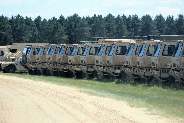 Military vehicles are lined up near Improved Tactical Training Base Freedom for use in the 86th Training Division's Combat Support Training Exercise 86-18-04 on June 7, 2018, at Fort McCoy, Wis. The exercise is part of the Army Reserve's Combat Support Training Program, or CSTP. CSTP exercises are large-scale, collective-training exercises designed to immerse units into tactical training environments that closely replicate what they might experience in operational deployments. The 86th Training Division is a tenant organization at Fort McCoy. (U.S. Army Photo by Scott T. Sturkol, Public Affairs Office, Fort McCoy, Wis.)