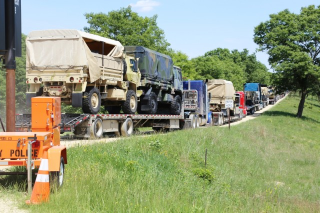 Tractor-trailers loaded with military equipment wait to get unloaded June 7, 2018, during preparation operations for the 86th Training Division's Combat Support Training Exercise 86-18-04 at Fort McCoy, Wis. The exercise is part of the Army Reserve's Combat Support Training Program, or CSTP. CSTP exercises are large-scale, collective-training exercises designed to immerse units into tactical training environments that closely replicate what they might experience in operational deployments. The 86th Training Division is a tenant organization at Fort McCoy. (U.S. Army Photo by Scott T. Sturkol, Public Affairs Office, Fort McCoy, Wis.)