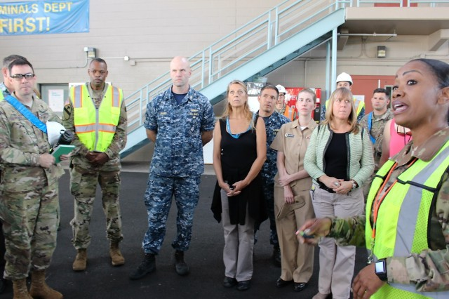 Lt. Col. Clydea Prichard-Brown (far right foreground), 836th Transportation Battalion commander, delivers a briefing to distinguished visitors during port operations at Pearl Harbor on Jan. 6, 2017.