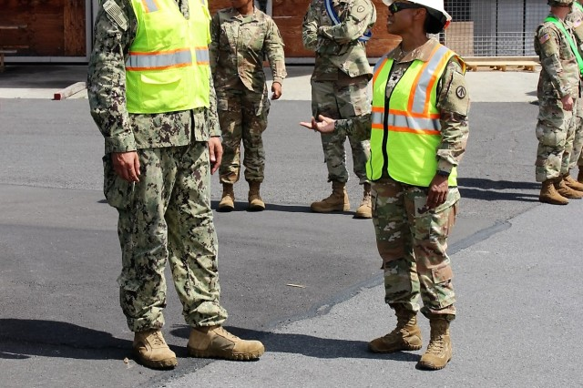 Lt. Col. Clydea Prichard-Brown, 836th Transportation Battalion commander, speaks with Lt. Cmdr. Calvin White, FLC-Pearl Harbor, during port operations at Pearl Harbor on Aug. 16, 2017.