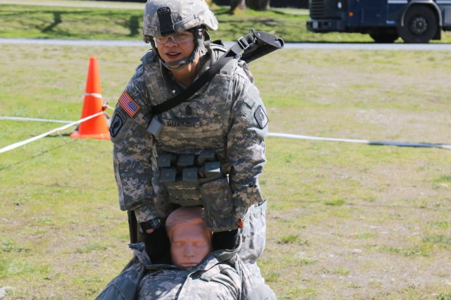 1st Sgt. Heather Buxton, 514 Ground Ambulance, 56th MMB, 62nd Medical Brigade drags an 180-pound dummy during a stress shoot April 18 at Joint Base Lewis-McChord, Washington. The stress shoot was part of the events schedules throughout the Best Warrior Competition April 17 to April 20.
