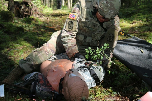 Spc. Oscar Ortiz, 542nd Support Maintenance Company, 13th CSSB provides casualty care during the medical lanes 19 April at Joint Base Lewis-McChord, Washington. The medical lane was part of the events schedules throughout the Best Warrior Competition April 17 to April 20.