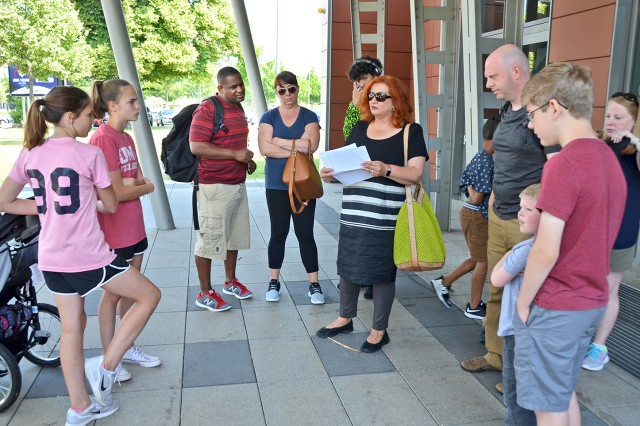 Army Community Service's Irmgard Goebel leads a group of newcomers on a Host Nation Orientation tour of Wiesbaden.