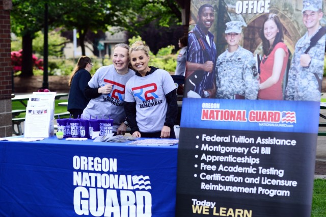 "Ann Browning (left) and 2nd Lt. Elena Miron, with the Oregon National Guard Education Services Office, pose for a photo at their booth providing information to military families about education benefits during the ""Run to Remember"" 5-kilometer run/walk event at Salem Riverfront Park, May 19, 2018, in Salem, Oregon."