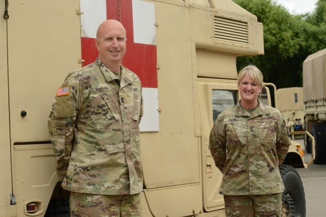 Oregon Army National Guard Sgt. 1st Class Zachary Pickett (left) currently assigned to Alpha Company, 1249th Engineer Battalion, pauses for a photograph with medic Sgt. 1st Class Angel Payne (right) at the Anderson Readiness Center motor pool, Salem, Oregon, May 31, 2018.