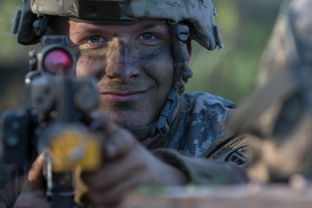 Spc. Lucas Underwood, a paratrooper assigned to the U.S. Army's 1st Battalion, 508th Infantry Regiment, 3rd Brigade Combat Team, 82nd Airborne Division, pulls security after jumping from an aircraft near Rukla, Lithuania, as part of Swift Response 18, June 9, 2018.