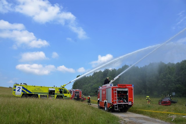 German and U.S. fire fighters put out simulated forest fires during a recent joint U.S. and host nation exercise June 7, 2017 at USAG Ansbach's Oberdachstetten training Area. (U.S. Army photo by Bianca Sowders, USAG Ansbach Public Affairs)