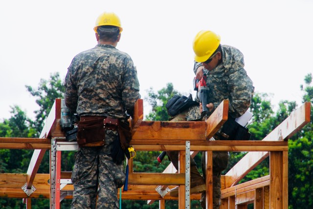 A Soldier from the 230th Vertical Engineer Company, Hawaii Army National Guard, trims the wood framings of one of the micro-shelters being built in Pahoa, Hawaii, June 7, 2018.
