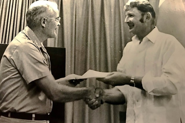 Alfred Budris receives a Commander's Award for Civilian Service from the commander, Headquarters, U.S. Army Garrison Okinawa in 1973. (Courtesy photo)