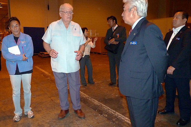 Alfred Budris briefs the mayor of Urasoe, Okinawa on Logistics Readiness Center warehouse capabilities 2012. (Courtesy photo)