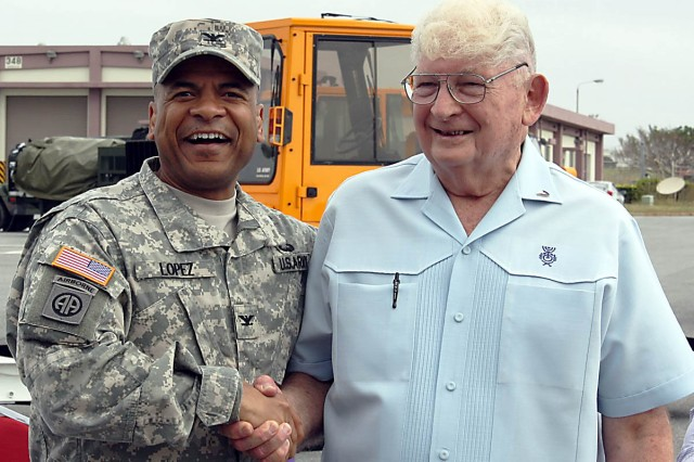 Col. Michael Lopez, 403rd Army Field Support Brigade commander, and Alfred Budris. Lopez welcomes the Logistics Readiness Center-LRC Torii Station to the brigade in October 2012. (Courtesy photo)