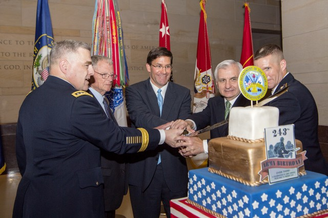 Chief of Staff of the Army Gen. Mark A. Milley, Sen. Jim Inhofe of Oklahoma, Secretary of the Army Dr. Mark T. Esper, Sen. Jack Reed of Rhode Island, and Sgt. Maj. of the Army Daniel A. Dailey use a ceremonial saber to cut an Army birthday cake, June 13, 2018, on Capitol Hill, Washington, D.C.