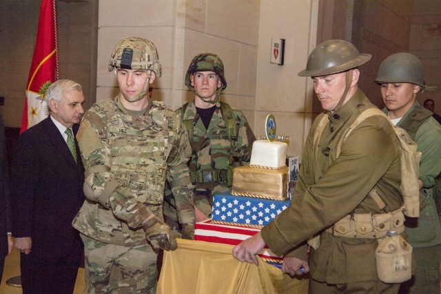 Soldiers bring out a birthday cake on Capitol Hill as part of an Army birthday celebration there, June 13, 2018, in Washington, D.C.