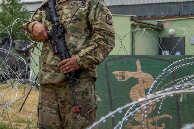 U.S. Army Reserve Staff Sgt. Jonathan Fathag, a casualty liaison team leader with 406th Human Resource Company, Kaiserslautern, Germany, is embedded with the 30th Medical Brigade, Sembach, Germany, at their clinical operations section (CLINOPS) in Powidz, Poland to conduct casualty training exercises during Saber Strike 18 which runs from June 3-15. Saber Strike is a long-standing U.S. Army Europe-led integrated training exercise that helps facilitate cooperation amongst the U.S., Estonia, Latvia, Lithuania, Poland and 19 other allied and partner nations. (U.S. Army Reserve photo by Spc. Daisy Zimmer, 221st Public Affairs Detachment).