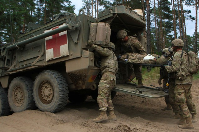 U.S. Army soldiers with 2nd platoon, Comanche Troop, 1st Squadron, 2nd Cavalry Regiment, Battle Group Poland, load a soldier with a simulated combat injury into a medical evacuation vehicle during a combat training situation as part of their participation in Saber Strike 18 at the Bemowo Piskie Training Area, Poland on June 13, 2018. Saber Strike 18 is the eighth iteration of the long-standing U.S. Army Europe-led cooperative training exercise designed to enhance interoperability among allies and regional partners. (Michigan Army National Guard photo by Spc. Robert Douglas/ released.)