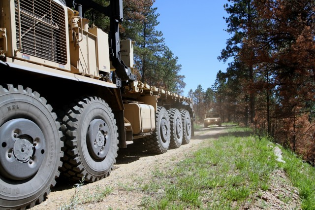 Soldiers of the 137th Transportation Company, Kansas Army National Guard, conduct convoy operations during the counter improvised explosive device training June 12, 2018, at Custer State Park, S.D. The CIED course is part of the Golden Coyote training exercise, which provides opportunities for units to practice their warrior tasks and prepare for real-world missions.