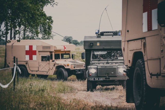 U.S. and British ambulances rush to the mass casualty exercise location to assist the medical staff from the Brittain, Polish, and the U.S. Armed Forces at Swidwin Air Field in Swidwin, Poland, June 11, 2018.