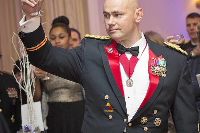 PICATINNY ARSENAL, N.J. - Lt. Col. Jeffrey Ivey raises his glass during a toast at the 2016 Holiday Ball.