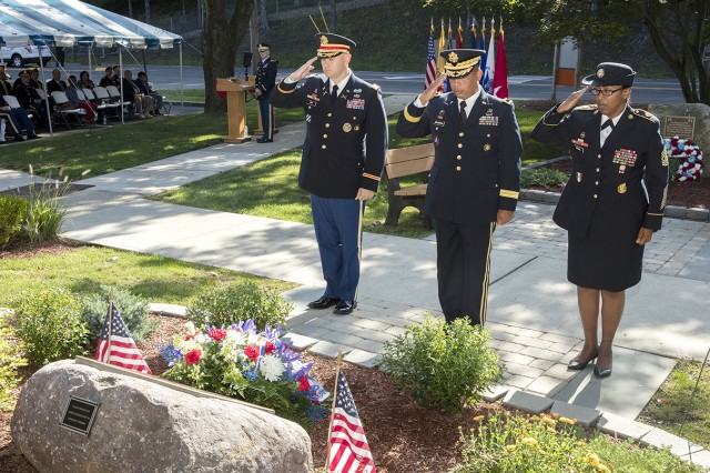 PICATINNY ARSENAL, N.J. - Lt. Col. Jeffrey Ivey, garrison commander, Brig. Gen. Alfred F. Abramson, senior command�er, and Command Sgt. Maj. Sheila Royal, command sergeant major, render honors during a memorial ceremony in recognition of 174 fallen service members.