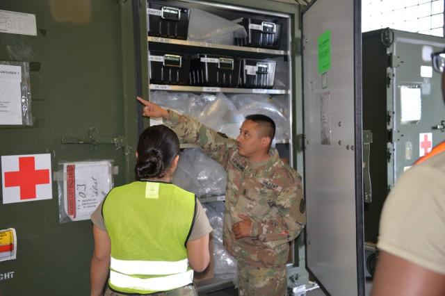 USAMMCE Sgt. Maj. Jose Raymundo and Private 1st Class Sabrina, Leguizamon, a USAMMCE medical logistics specialist, prepare the Consequence Management Set for transportation.