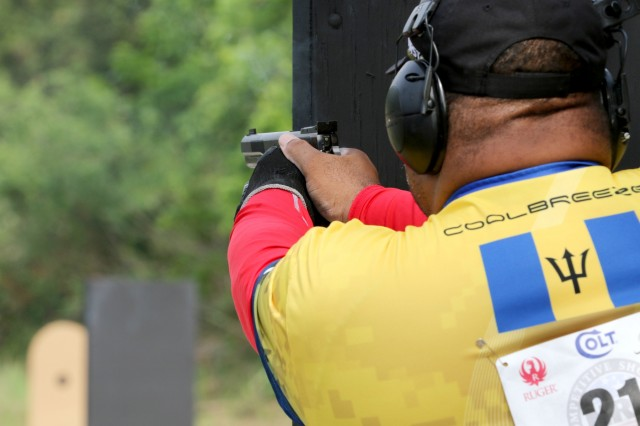 Ryan Best, a competitive shooter from Barbados,  fires his pistol during the Barricade Event at the 2018 World Action Pistol Championships in Columbia, Missouri May 19. After the three-day, four-event action pistol competition that drew more than 160 competitors from eight countries and 33 states, Best placed 18th in the WAPC Metallic Divison. (U.S. Army photo by Michelle Lunato/released)