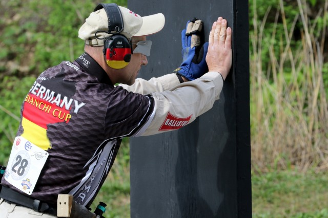 Roman Hauber, a competitive shooter from Germany, stands at the ready position during The Barricade Event at the 2018 World Action Pistol Championships in Columbia, Missouri May 19. After the three-day, four-event action pistol competition that drew more than 160 competitors from eight countries and 33 states, Hauber placed 4th in the WAPC and 3rd in the proceeding Bianchi Cup, both in the Metallic Division. (U.S. Army photo by Michelle Lunato/released)