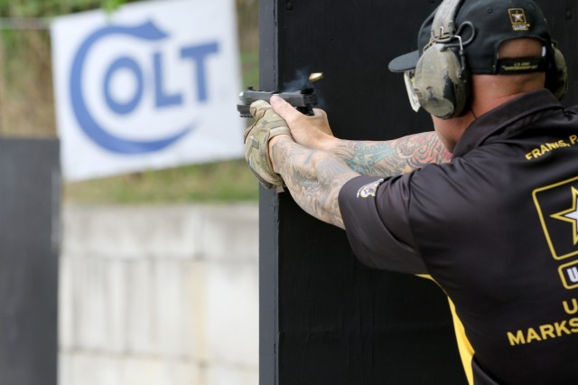 U.S. Army Sgt. 1st Class Patrick Franks, a Las Vegas, Nevada native with the U.S. Army Marksmanship Unit's Service Pistol Team, fires his pistol during The Barricade Event at the 2018 World Action Pistol Championships in Columbia, Missouri May 19. After the three-day, four-event action pistol competition that drew more than 160 competitors from eight countries and 33 states, the U.S. Army Soldier claimed the Production Division World Champion title. (U.S. Army photo by Michelle Lunato/released)