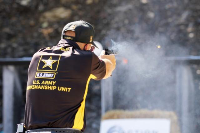Sgt. 1st Class Adam Sokolowski, a Somerville, New Jersey native with the U.S. Army Marksmanship Unit's Service Pistol Team, fires his pistol during The Falling Plate Event at the 2018 Bianchi Cup Multigun Match in Columbia, Missouri May 22. The three-day, four-event action pistol competition drew more than 160 competitors from eight countries and 33 states. Sokolowski claimed 1st Place in the not only the Multigun Match but the overall Bianchi Cup by seizing the Open Division and making history as the first shooting sports athlete in 40 years of the competition to win all three divisions-Production, Metallic and Open-in three consecutive years. (U.S. Army photo by Michelle Lunato/released)