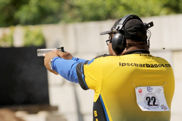 Ryan Best, a shooting sports athlete from Barbados, competes in The Practical Event at the 2018 Bianchi Cup Multigun Match in Columbia, Missouri May 22. The three-day, four-event action pistol competition drew more than 160 competitors from eight countries and 33 states. (U.S. Army photo by Michelle Lunato/released)