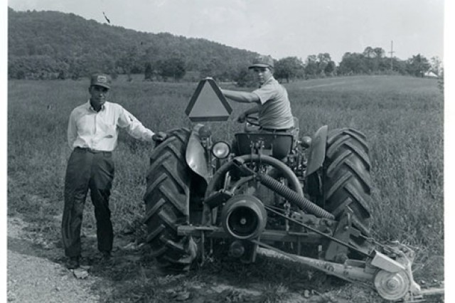 Army veteran Garlin Conner (left) retreated to working on a tobacco farm following his military service in World War II. He is shown here pictured with his son, Paul, on the family's farm in the outskirts of Albany, Kentucky.