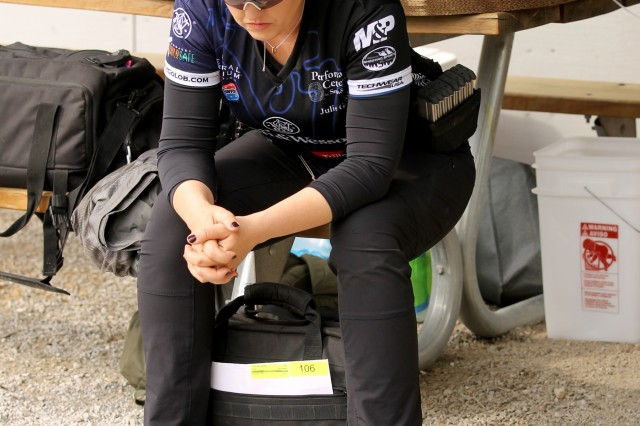 U.S. Army Marksmanship Unit alumni Julie Golob, who is now with Smith & Wesson, takes a moment to mentally prepare herself for The Moving Target Event at the 2018 Bianchi Cup in Columbia, Missouri May 25. After the three-day, four-event action pistol competition that drew more than 160 competitors from eight countries and 33 states, the USAMU veteran placed 6th in the Ladies Open Division, right behind USAMU's Sgt. Katlin Bahten. (U.S. Army photo by Michelle Lunato/released)