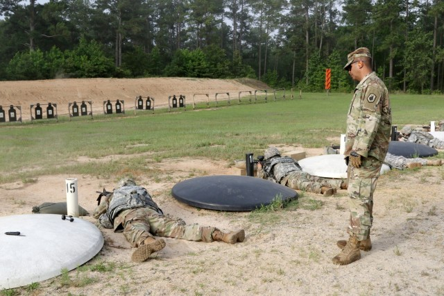 U.S. Army Reserve Sgt. 1st Class Louis Rodriguez, a senior drill sergeant with the 98th Training Division (Initial Entry Training) out of Sacramento California, watches over a Soldier on the Zero Range during the 2018 U.S. Army Reserve Best Warrior Competition at Fort Bragg June 10. More than 35 Soldiers representing seven Geographic Commands and 22 Functional Commands, will spend the week competing in a variety of challenges including firing weapons, land navigation, the Army Physical Fitness Test, and various mystery events. These challenges will ultimately test their capabilities, combat-readiness, and lethality. The Army Reserve's top Soldier and NCO of the Year and will compete against winners from the major Army commands in October at Fort A.P. Hill, Va. (U.S. Army Reserve photo by Maj. Michelle Lunato/Released)