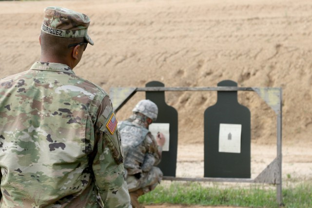 U.S. Army Reserve Sgt. 1st Class Louis Rodriguez, a senior drill sergeant with the 98th Training Division (Initial Entry Training) out of Sacramento California, watches over a Soldier as he marks his target at the Zero Range during the 2018 U.S. Army Reserve Best Warrior Competition at Fort Bragg June 10.  More than 35 Soldiers representing seven Geographic Commands and 22 Functional Commands, will spend the week competing in a variety of challenges including firing weapons, land navigation, the Army Physical Fitness Test, and various mystery events. These challenges will ultimately test their capabilities, combat-readiness, and lethality. The Army Reserve's top Soldier and NCO of the Year and will compete against winners from the major Army commands in October at Fort A.P. Hill, Va. (U.S. Army Reserve photo by Maj. Michelle Lunato/Released)