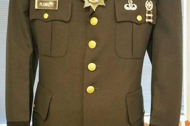 The uniform of U.S. Army 1st Lt. Ronald Alan Plunkett, a former special forces medic and physician's assistant who served with Team Delta, 3rd Group Special Forces, shows a glimpse of his years and conduct in service, said U.S. Army Reserve Sgt. 1st Class Louis Rodriguez, a senior drill sergeant with Bravo Troop, 2nd Squadron (Cavalry One Station Unit Training), 415th Regiment, 1st Brigade, 98th Training Division (Initial Entry Training), who spread Plunkett's ashes while on a mission at Fort Bragg June 16. (U.S. Army Reserve Courtesy photo/released)