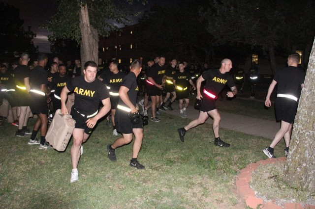 Soldiers run with water cans and kettlebells of various weights in the Spiritual Fitness Olympiad hosted by 2nd Battalion, 4th Field Artillery May 18, 2018, at Fort Sill. The fitness challenge tested Soldiers ability to complete events despite competing under unfair circumstances.