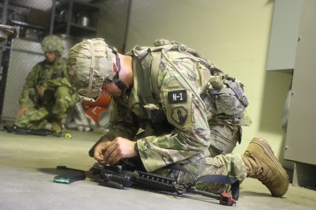U.S. Army Reserve Sgt. Carlos Fuentes, an information technology specialist representing the 166th Regional Support Group, 1st Mission Support Command, competes in the assemble and reassemble weapon event at the 2018 U.S. Army Reserve Best Warrior Competition at Fort Bragg, North Carolina, June 10, 2018.