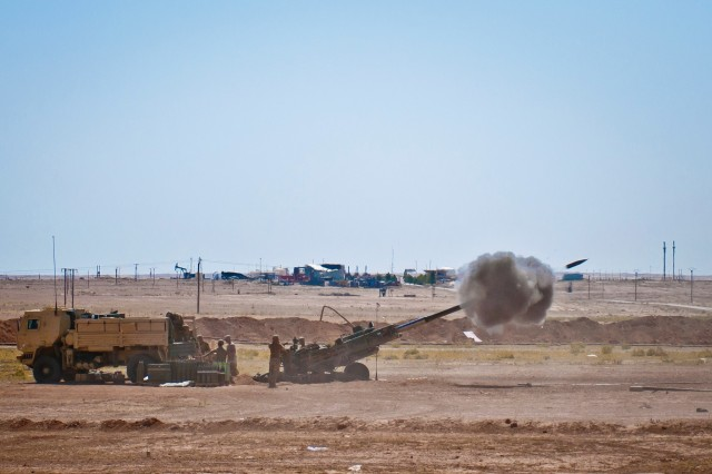 Coalition advisors turn their M777 Howitzer to prepare for a new fire mission at an outpost near Dashisha, Syria, June 9, 2018. The Coalition has provided assistance and training to the Syrian Democratic Forces as they continue to reclaim their homeland from ISIS during Operation Roundup. (U.S. Army photo by Staff Sgt. Timothy R. Koster)