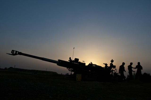Coalition advisors prepare for another night of fire missions at an outpost near Dashisha, Syria, June 8, 2018. The Coalition provides indirect fire missions to support the Syrian Democratic Forces during Operation Roundup, the SDF-led military offensive to eliminate the remaining pockets of ISIS fighters in the country. (U.S. Army photo by Staff Sgt. Timothy R. Koster)