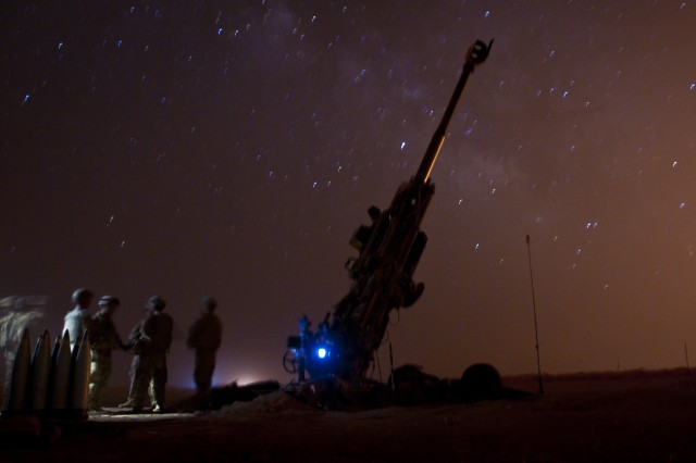 Coalition partners wait near their M777 Howitzer for their next fire mission to assist the Syrian Democratic Forces during Operation Roundup near an outpost near Dashisha, Syria, June 8, 2018. Operation Roundup is the SDF-led military offensive to eliminate the remaining pockets of ISIS fighters from Syria. (U.S. Army photo by Staff Sgt. Timothy R. Koster)