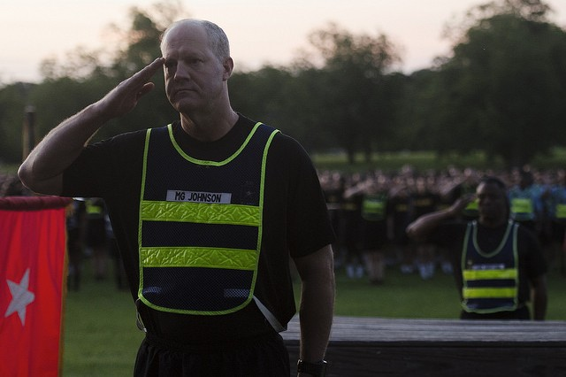 Maj. Gen. Pete Johnson, Fort Jackson commander, renders honors before a post run June 2 that celebrated the post's 101 years of training American Soldiers.