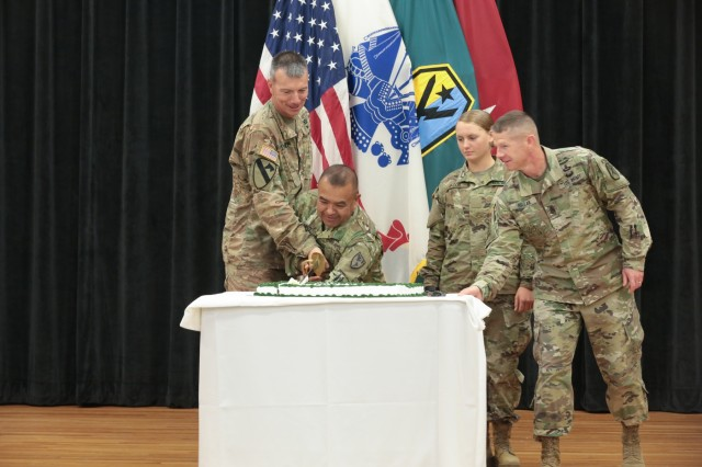 FORT BENNING, Ga. (June 14, 2018) - Staff Sgt. William Lopez, second from left, an instructor at the Western Hemisphere Institute for Security Cooperation, one of the most senior Soldiers on post, made the first cut of the cake with Brig. Gen. David A. Lesperance, left, the U.S. Army Armor School commandant. Pvt. Emmaleigh Jacob, second from right, Echo Company, 2nd Battalion, 58th Infantry Regiment, one of the most junior Soldiers on post, made the second cut of the cake with Maneuver Center of Excellence Command Sgt. Maj. Scott A. Brzak, right. The Maneuver Center of Excellence held a cake-cutting ceremony June 14 at the headquarters at Fort Benning, Georgia, in celebration of the 243rd anniversary of the U.S. Army's founding in 1775. (U.S. Army photo by Markeith Horace, Maneuver Center of Excellence, Fort Benning Public Affairs)