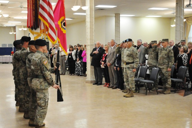 United States Army senior leaders and community guests stand at attention during the presentation of the JMC command colors during the Assumption of Command Ceremony held on the Rock Island Arsenal, June 14.