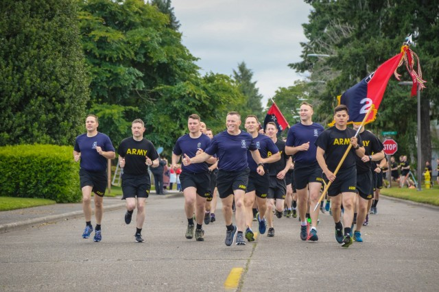 Soldiers and leaders with America's First Corps conduct a corps-wide run as part of the unit's celebration in honor of the Army's 243rd birthday, at Joint Base Lewis-McChord, Washington, June 14, 2018. This year also marks the 100th birthday of America's First Corps which was activated January 15, 1918, in France during WWI. (U.S. Army photo by Staff Sgt. Michael Armstrong, 7th Infantry Division)